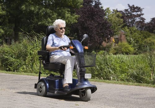 Senior woman riding an electric scooter