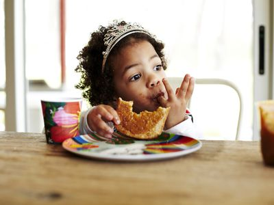 Girl eating lunch at a table