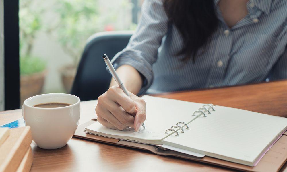 woman writing list