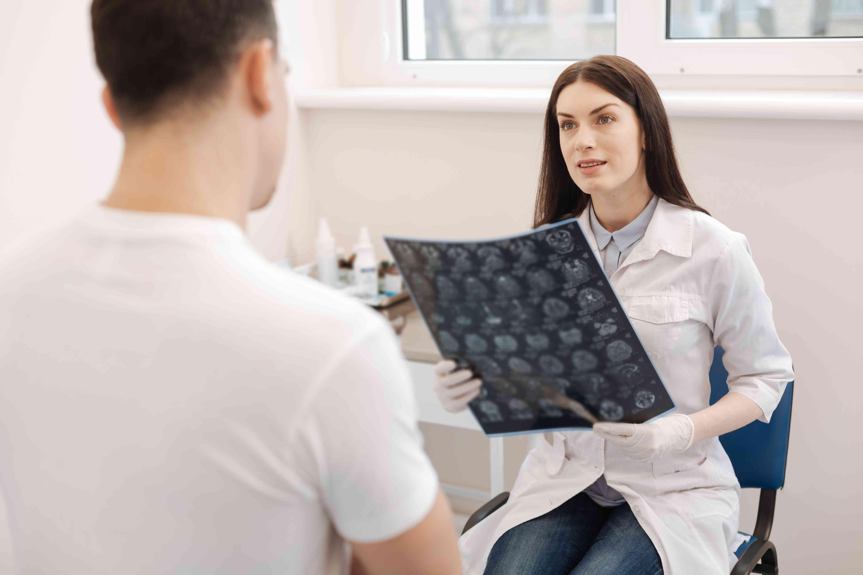 Doctor talking with patient in exam room