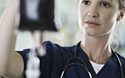 Nurse checking blood bag.
