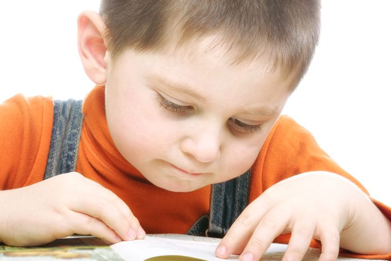 small child reading