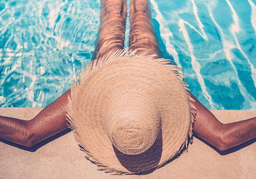 woman suntanning in a pool