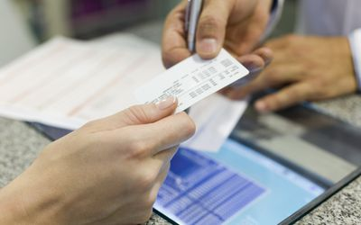 woman handing insurance card to man