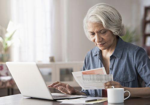Woman paying bills on laptop