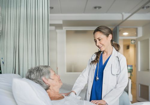 A doctor talking to her patient in the hospita