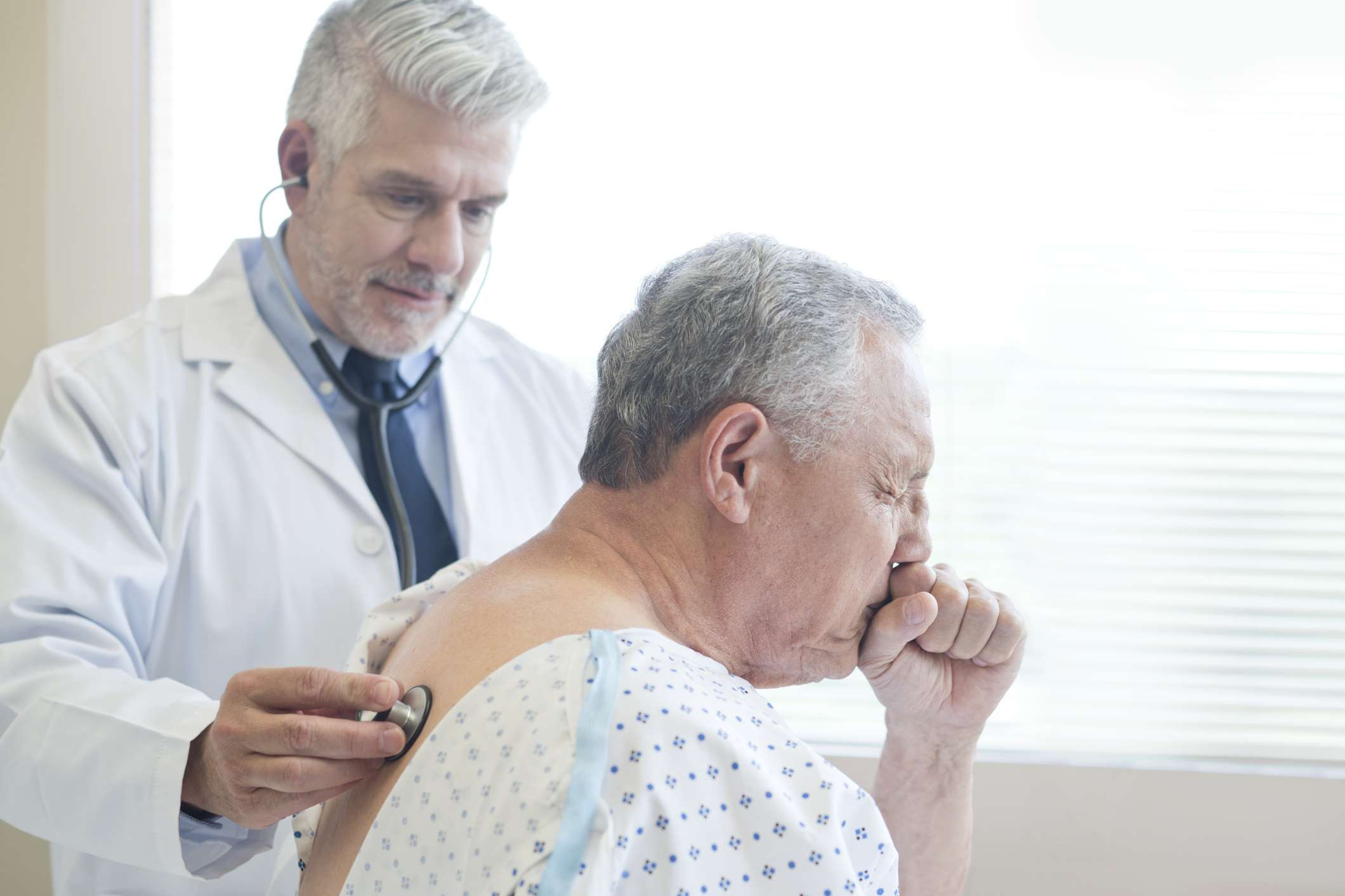 Doctor examining patient for bronchitis