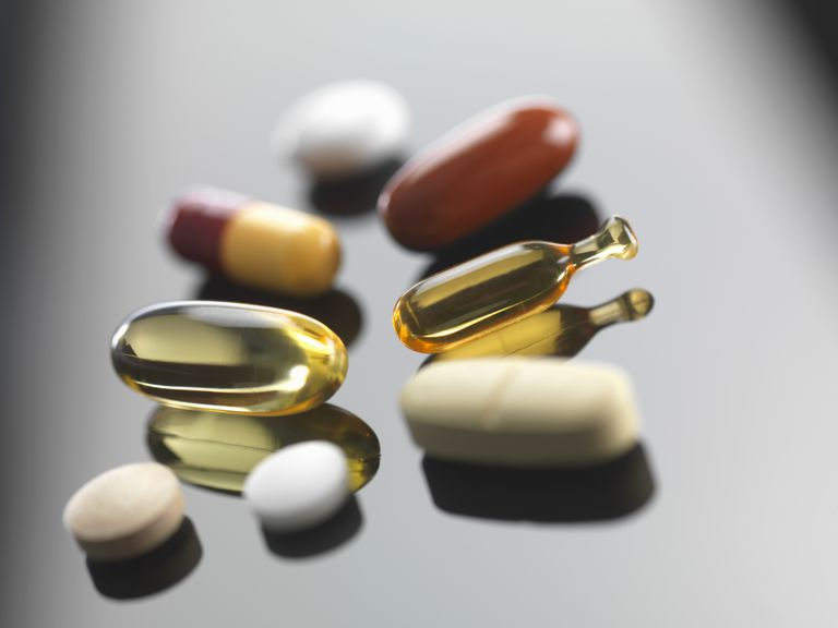 herbal supplement pills on table