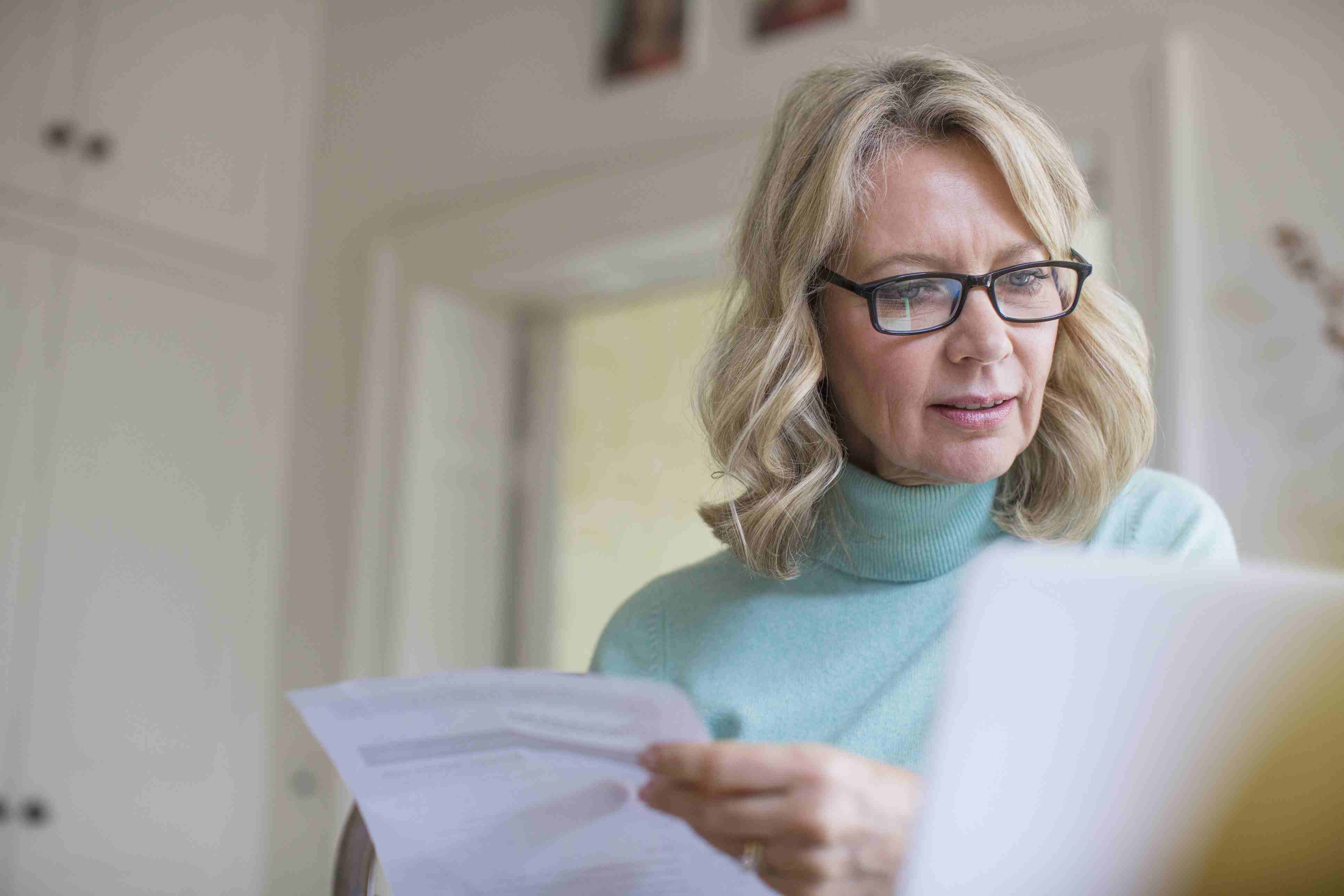 Mature female freelancer working at laptop at home