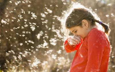 Young girl sneezing