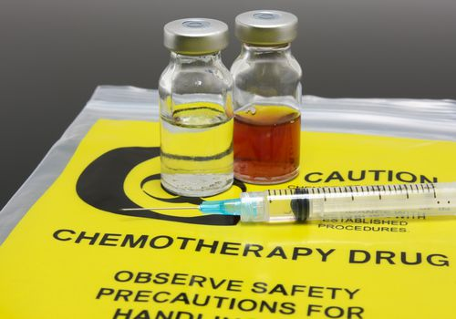 A syringe and chemotherapy drugs, with Neupogen to increase white blood cell counts