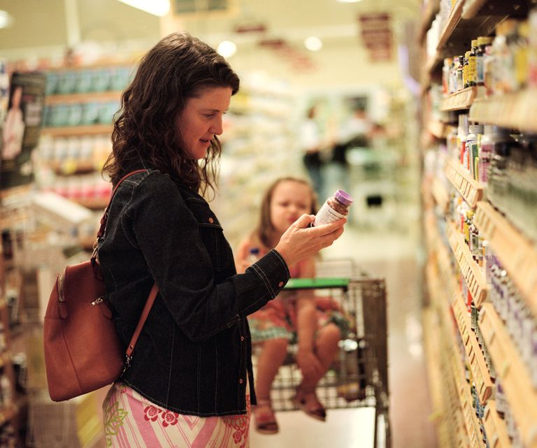 Woman in a store choosing a silicon supplement