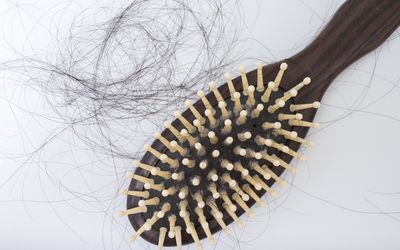 Hair brush with loose strands of hair