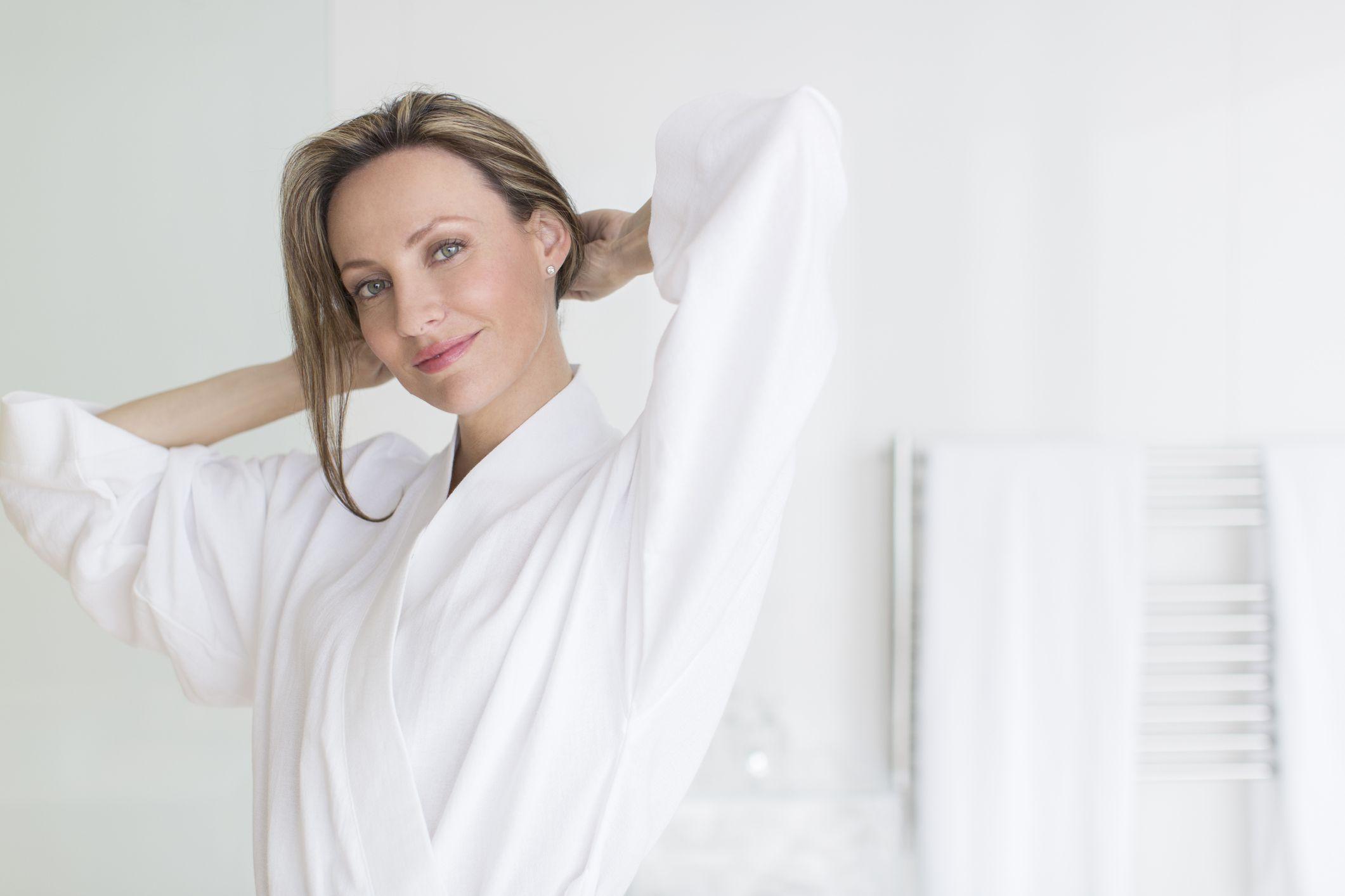 Smiling woman wearing bathrobe