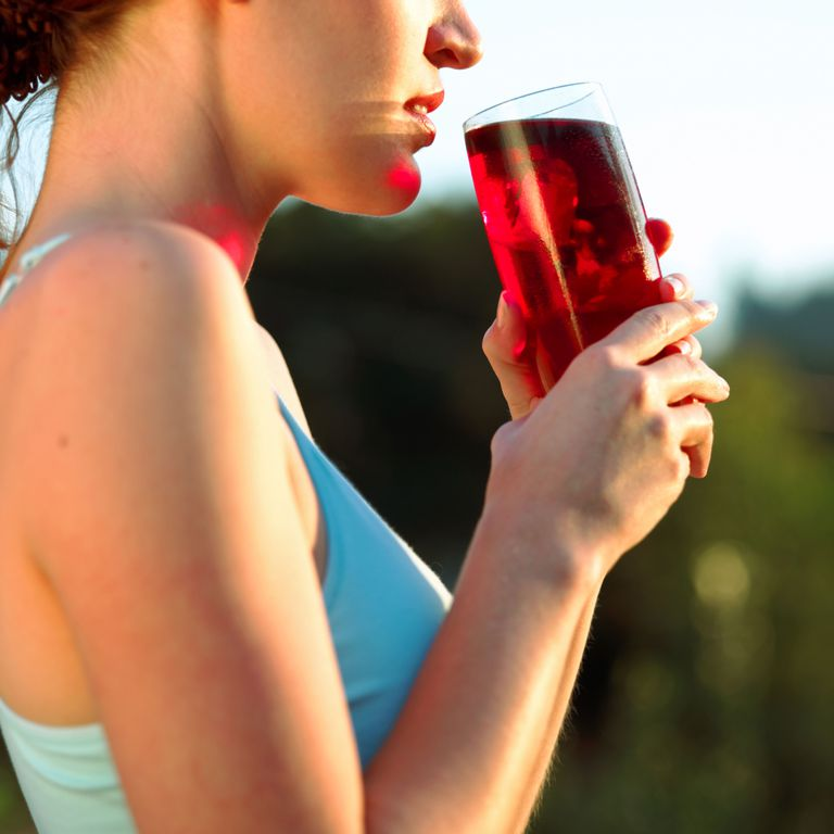 Woman drinking cranberry juice