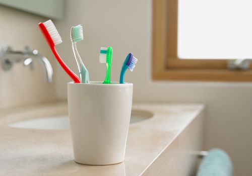 Toothbrushes in a cup.