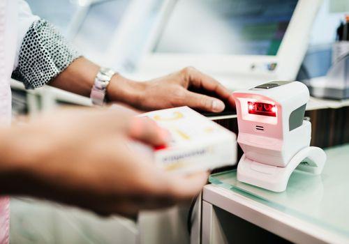 Pharmacist scanning prescription