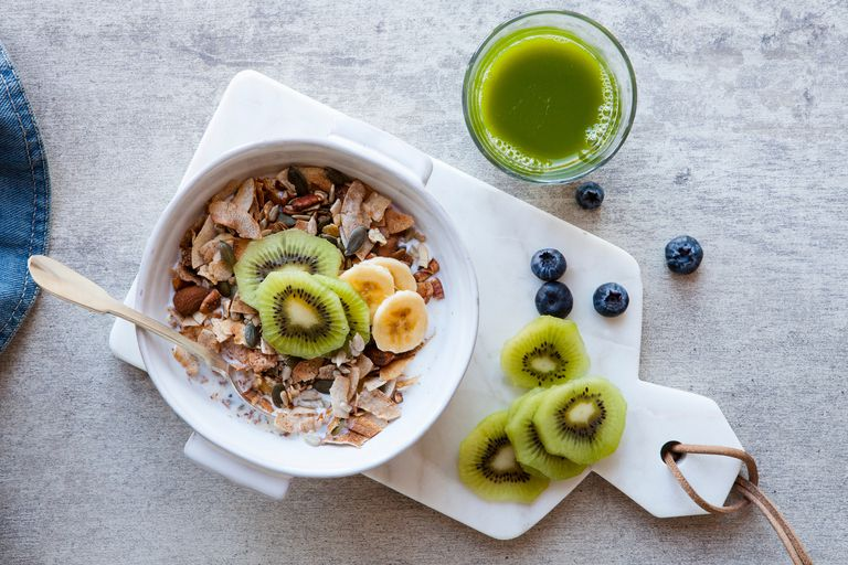 Kiwi and granola with nuts