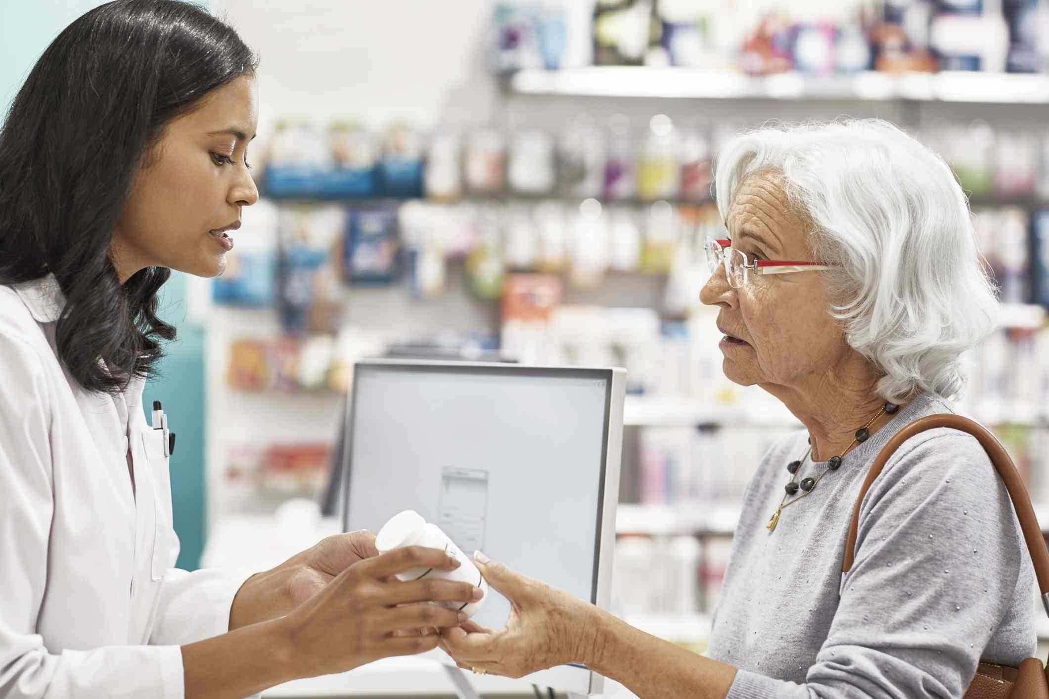 Pharmacist advises woman on drug interactions