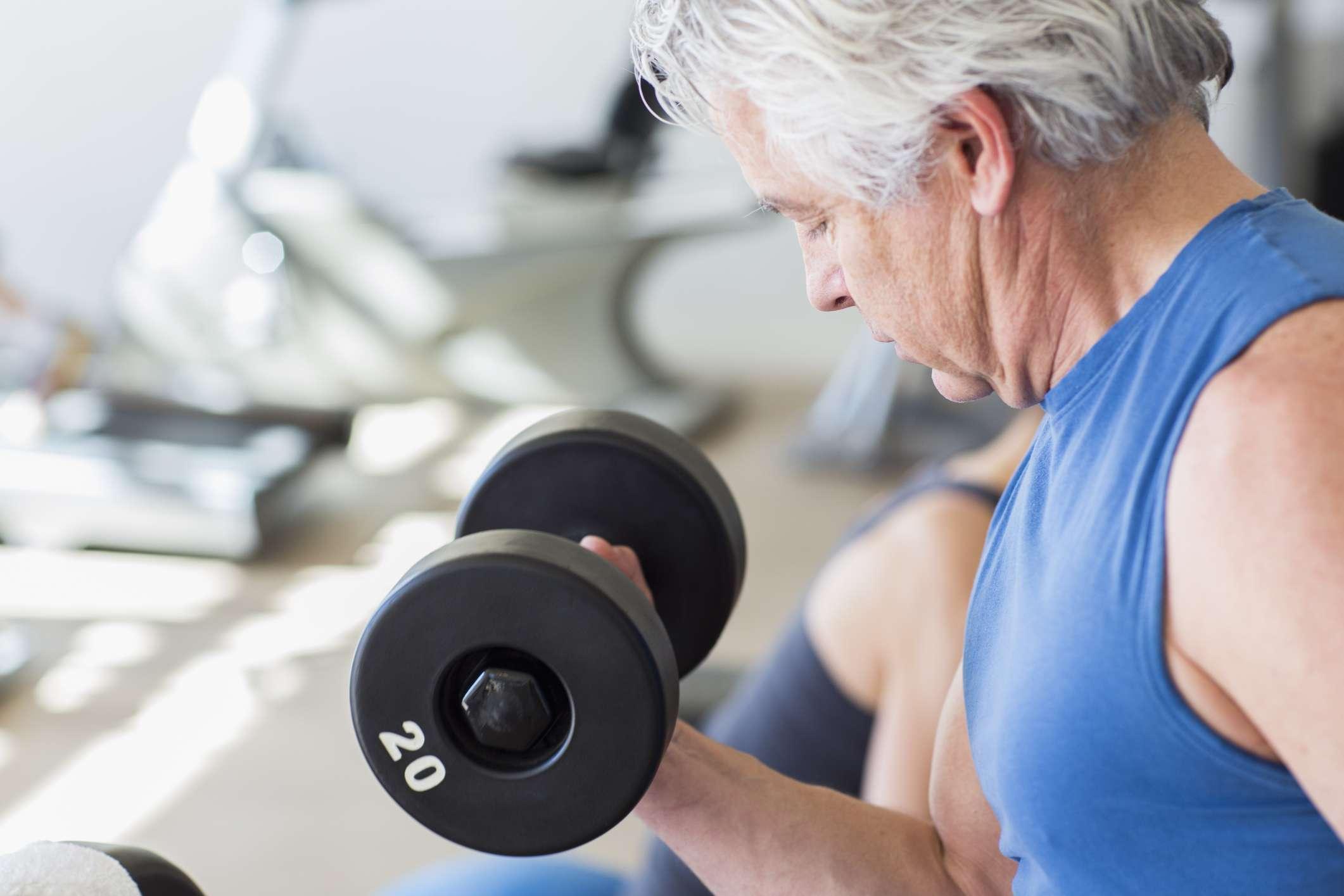 Older man weight lifting