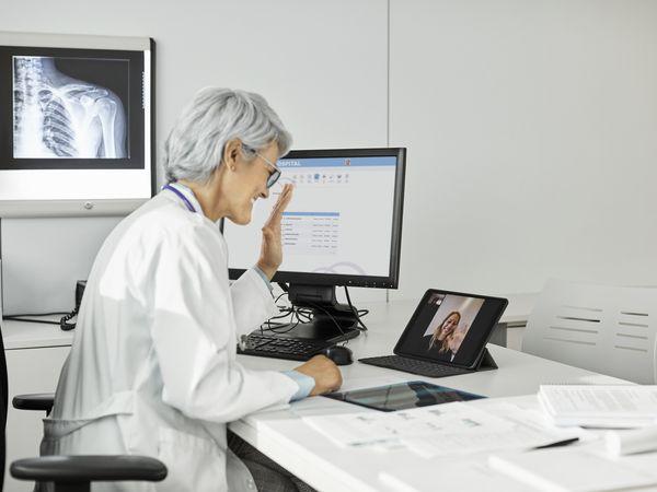 female doctor giving online consultation