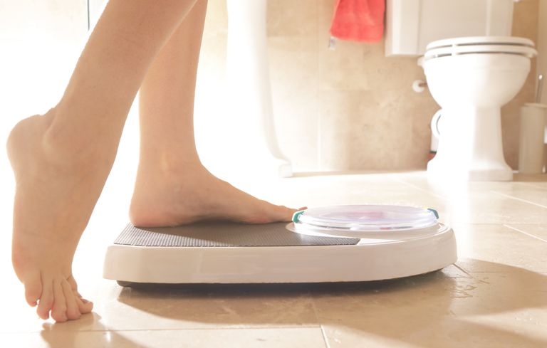 Stepping onto weighing scales