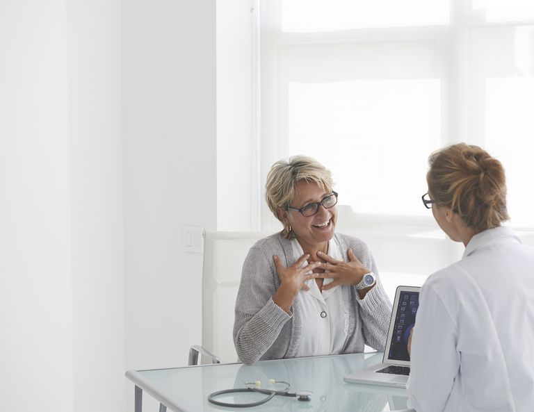 Patient talking to doctor in a medical clinic