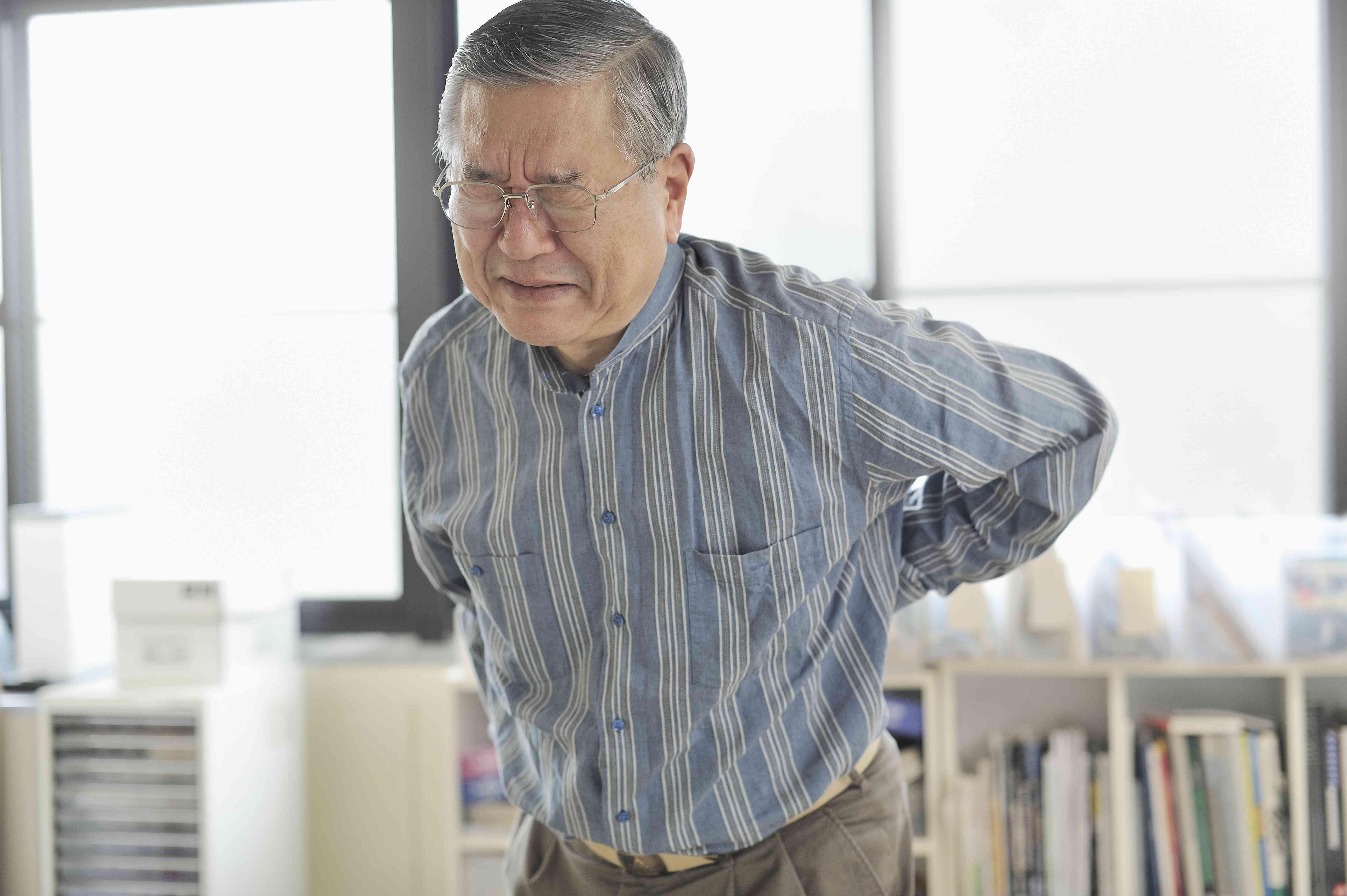 Man in lower back pain in an office