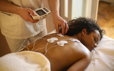 Young woman during an electrical stimulation therapy. -stock photo