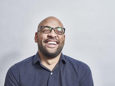 Mixed race male laughing with his head back