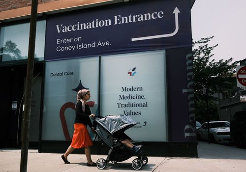 A doctors office advertises the Covid-19 vaccine in a neighborhood near Brighton Beach