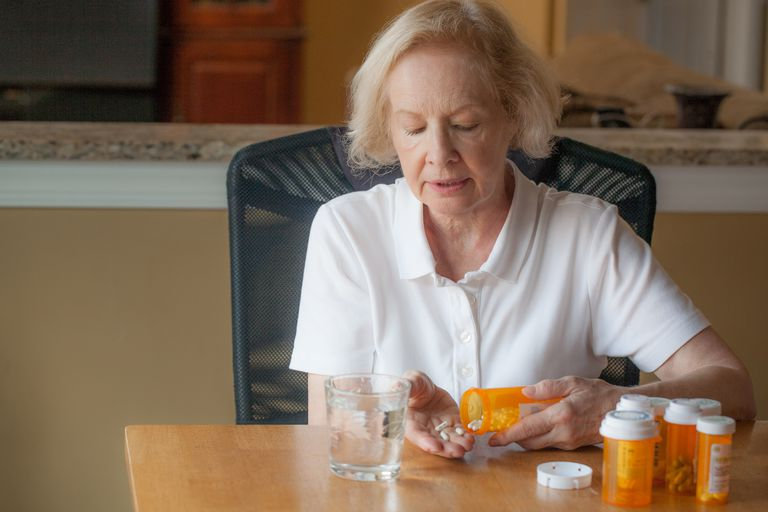 Senior woman taking her daily medicine