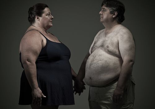 Obese couple holding hands
