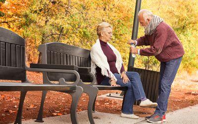 Senior woman does not feel good while senior man comforts him