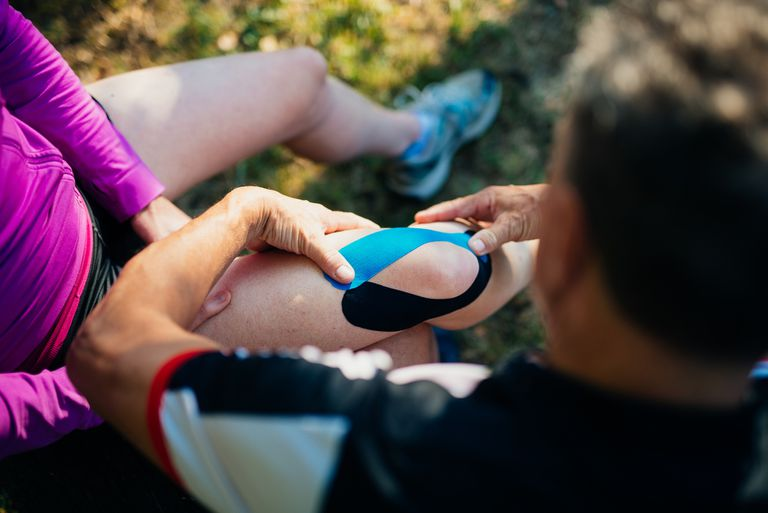 Woman getting her knee taped