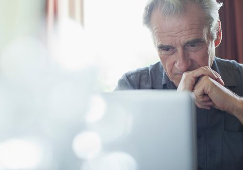 Older man on laptop