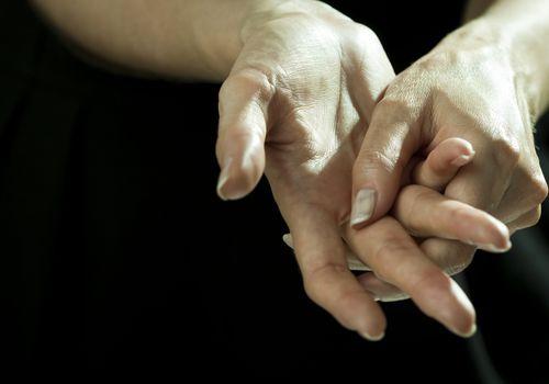 woman rubbing her fingers