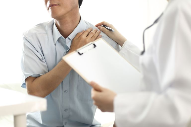 Doctor examining patient's shoulder