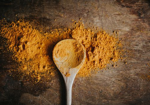 Wooden spoon with turmeric