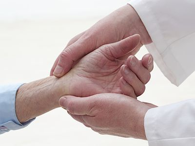 Doctor examining a wrist.