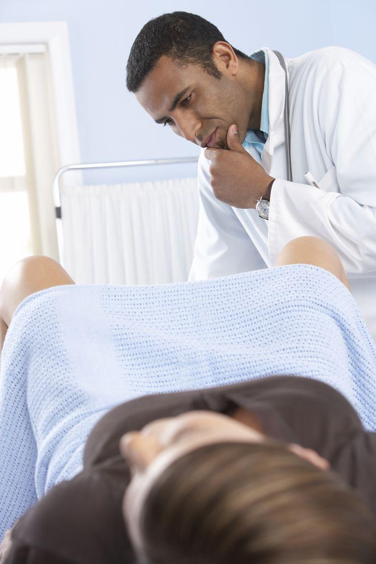 Gynecologist during examination