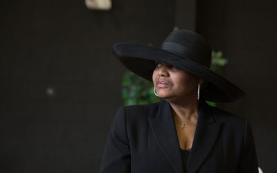 A widow in dressed in black at a funeral