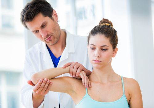 Medical consultation Doctor examining elbows