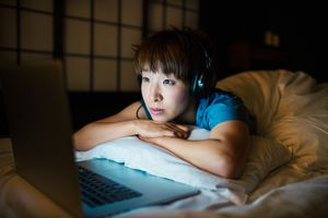 Woman watching TV in bed may be a night owl with delayed sleep phase syndrome