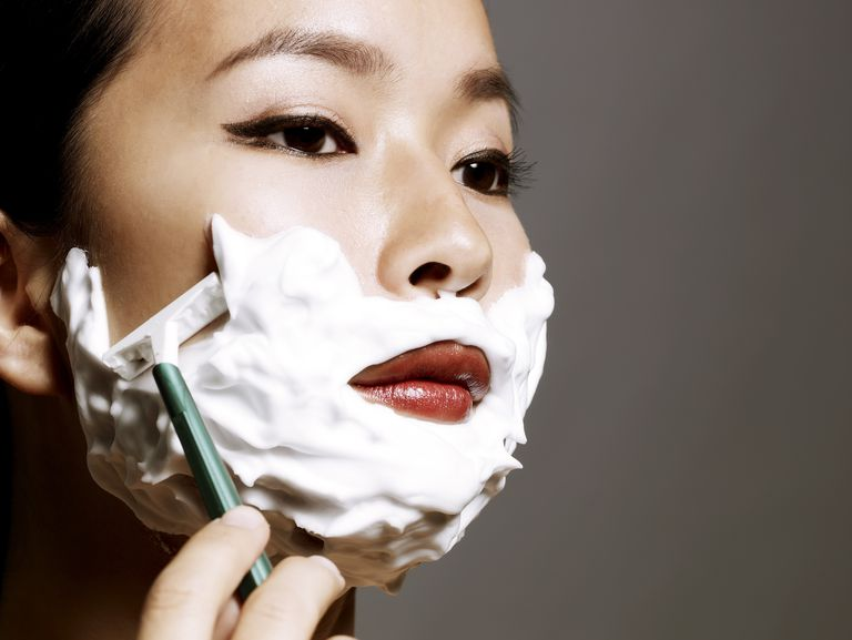 young Asian woman shaving