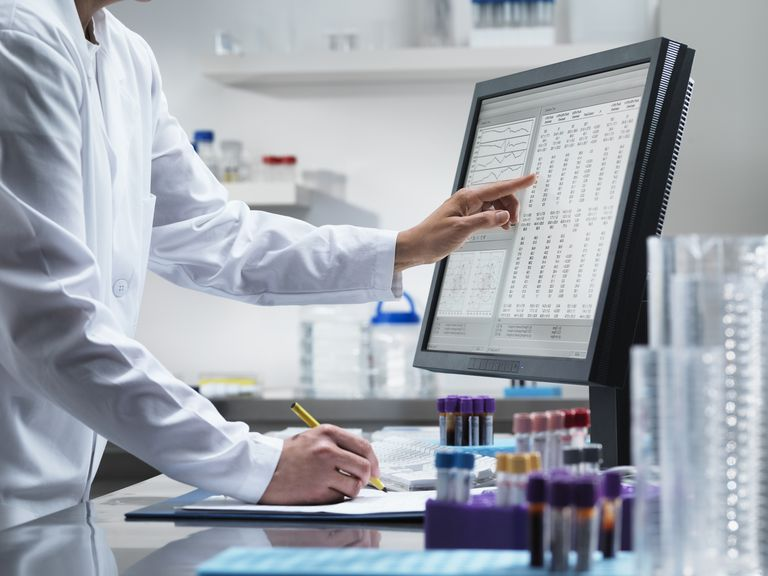 scientist evaluating clinical trial data on computer