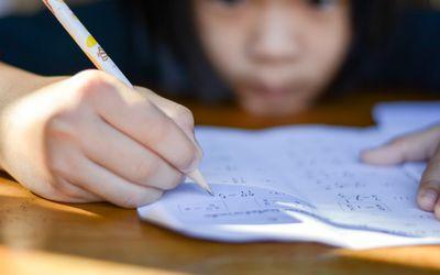Child doing math homework