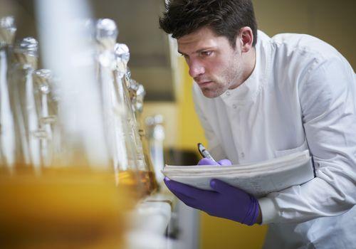 Scientist taking notes in lab