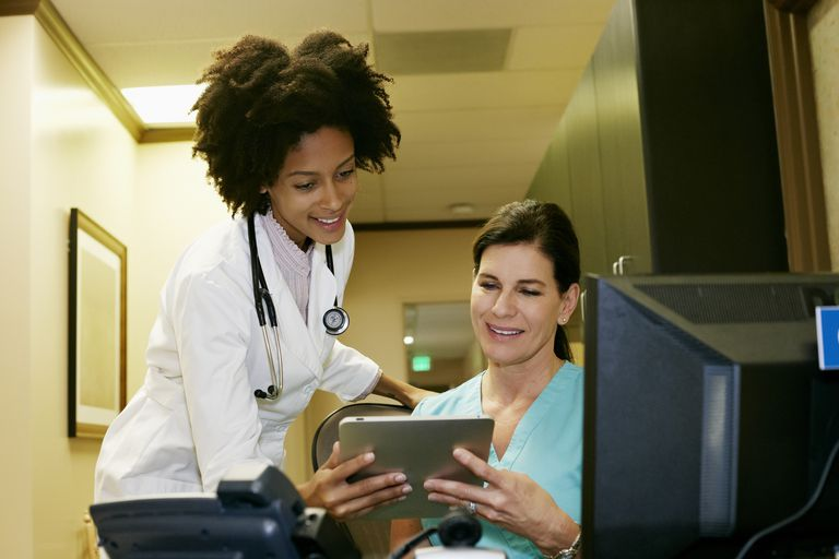 Doctor and nurse using digital tablet