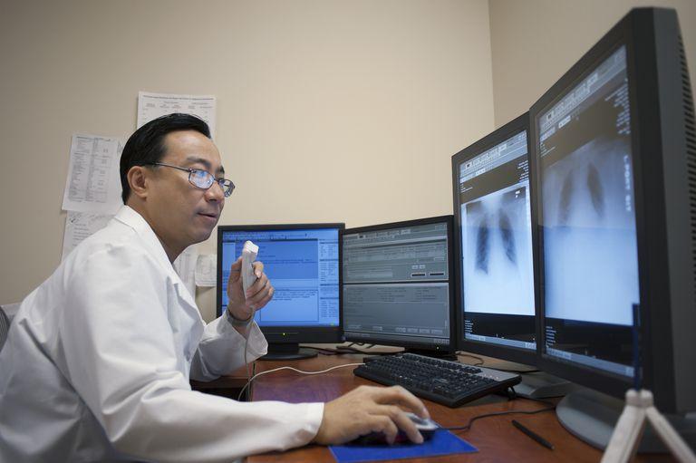 Technician examining diagnostic image